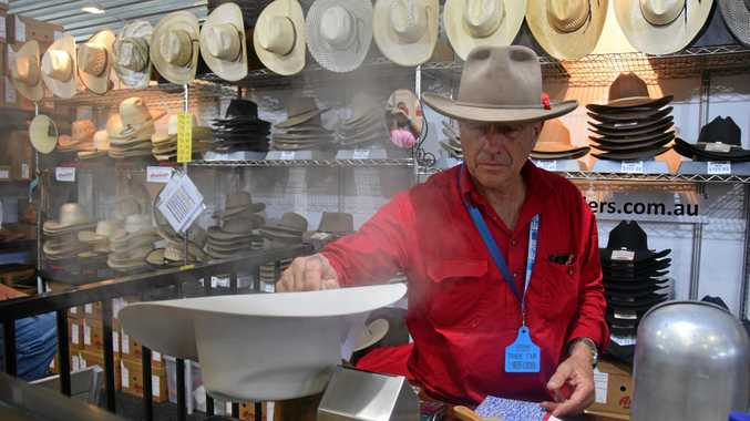 OLD-FASHIONED ART: Allan King working and shaping a hat with a
