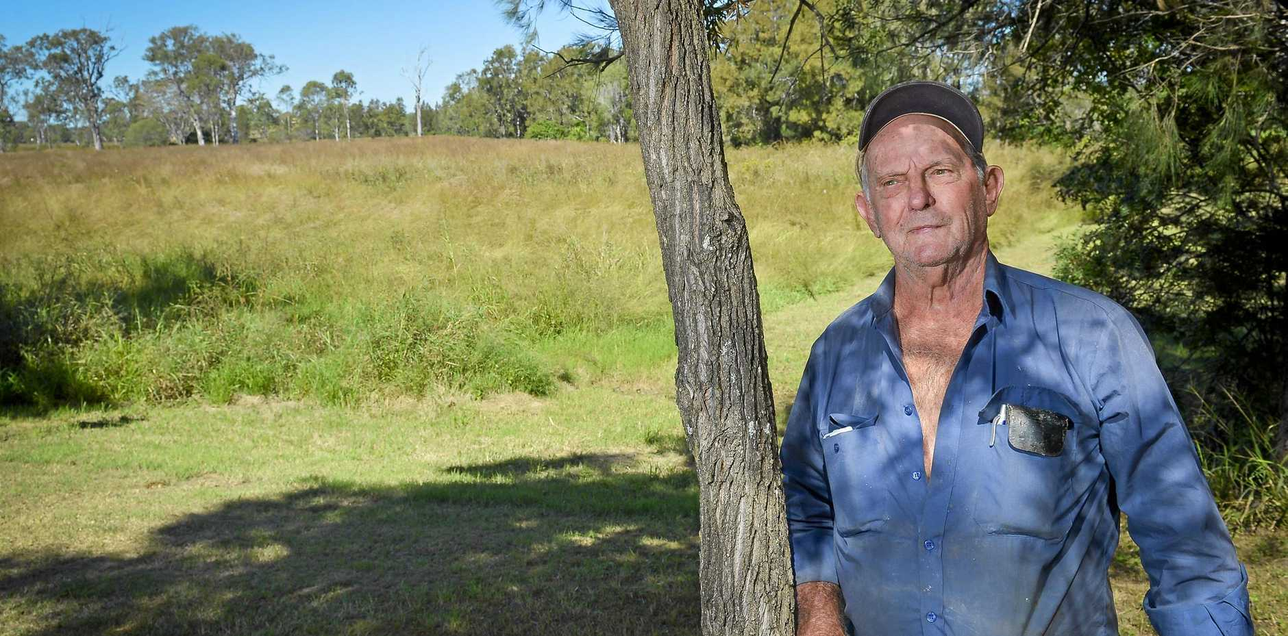 NOT HAPPY: Man Mick Gunston believes council are to blame for the rise in snakes, after not tending to Jaycees Park. INSET: The last time the park was mowed