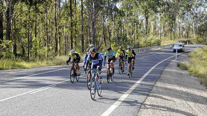 SUPPORT CREW: Three Grafton Cycle Club riders, David Hislop (left), Garry Reardon and Howard Avery sit behind the Inverell RSM Division 3 cyclists after making it through the initial climb of the Grafton to Inverell Cycle Classic at Cattle Creek Station.