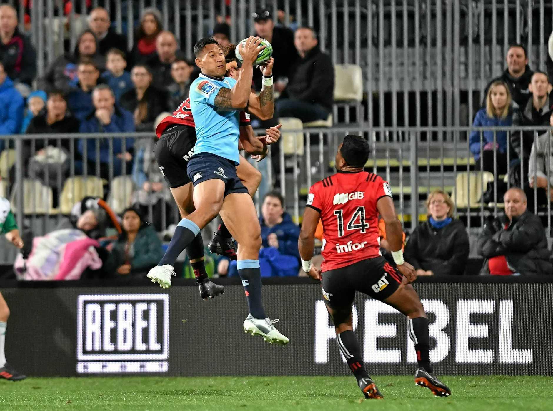 The Waratahs' Israel Folau flies high against the Crusaders at Christchurch's AMI Stadium on Saturday.