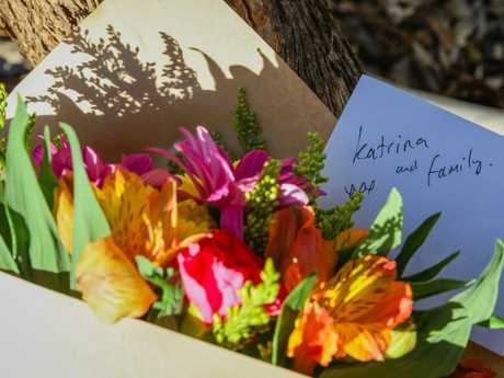 Flowers are left next to a police roadblock where police are investigating the shootings. Picture: AAP/Richard Wainwright