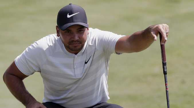 Woods surges into Sawgrass contention with third-round 65