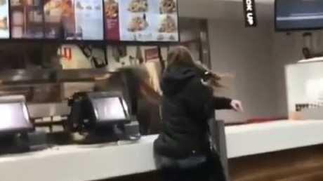 The woman hurls the EFTPOS machine at the menu screen. Video @YeahCeebs/@ShitAdelaide