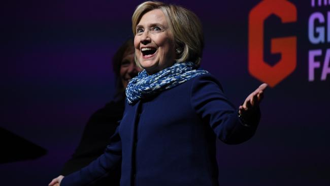 Former US secretary of state Hillary Clinton gestures to the crowd as she walks on stage during a Women World Changers Series event at the ICC Sydney Theatre in Sydney. Picture: AAP Image/David Moir