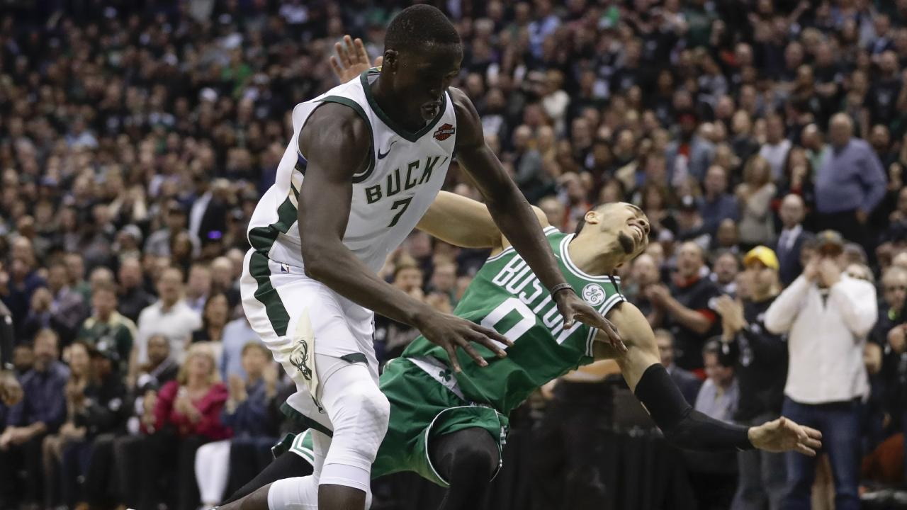 The Milwaukee Bucks' Thon Maker grabs a loose ball.