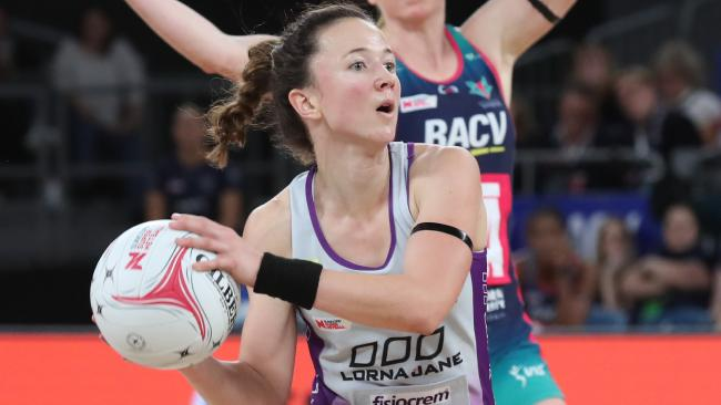 Caitlyn Nevins of the Firebirds looks to pass the ball. Picture: David Crosling/AAP