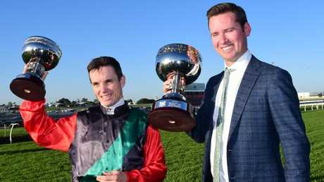 Jockey Tim Clark and co-trainer Adrian Bott were all smiles after English's win in the Doomben 10,000. Picture: Grant Peters, Trackside Photography