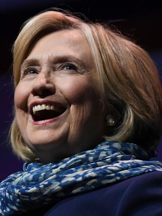 Former US secretary of state Hillary Clinton laughs as she walks on stage before speaking at a Women World Changers Series event at the ICC Sydney Theatre in Sydney. Picture: AAP /David Moir.