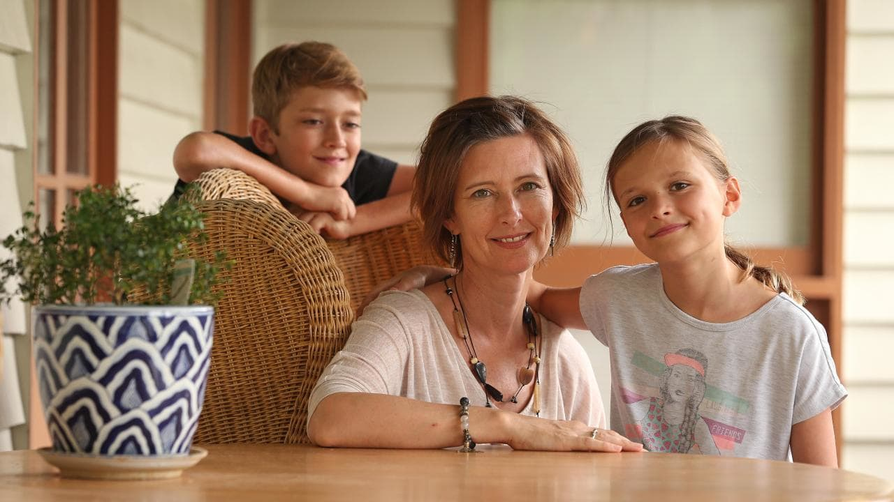 Jackie Rylance, founder of Brisbane-based au pair provider Dream Nannies, at home with her children James and Isabella. Picture: Lyndon Mechielsen