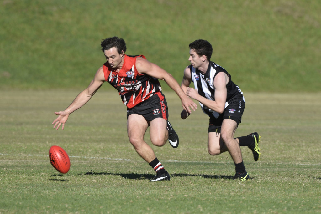 Todd Matthews of the Sawtell/Toormina Saints attacks the ball against the Port Macquarie Magpies. AFL North Coast 12 May 2018 Richardson Park Photo: Brad Greenshields