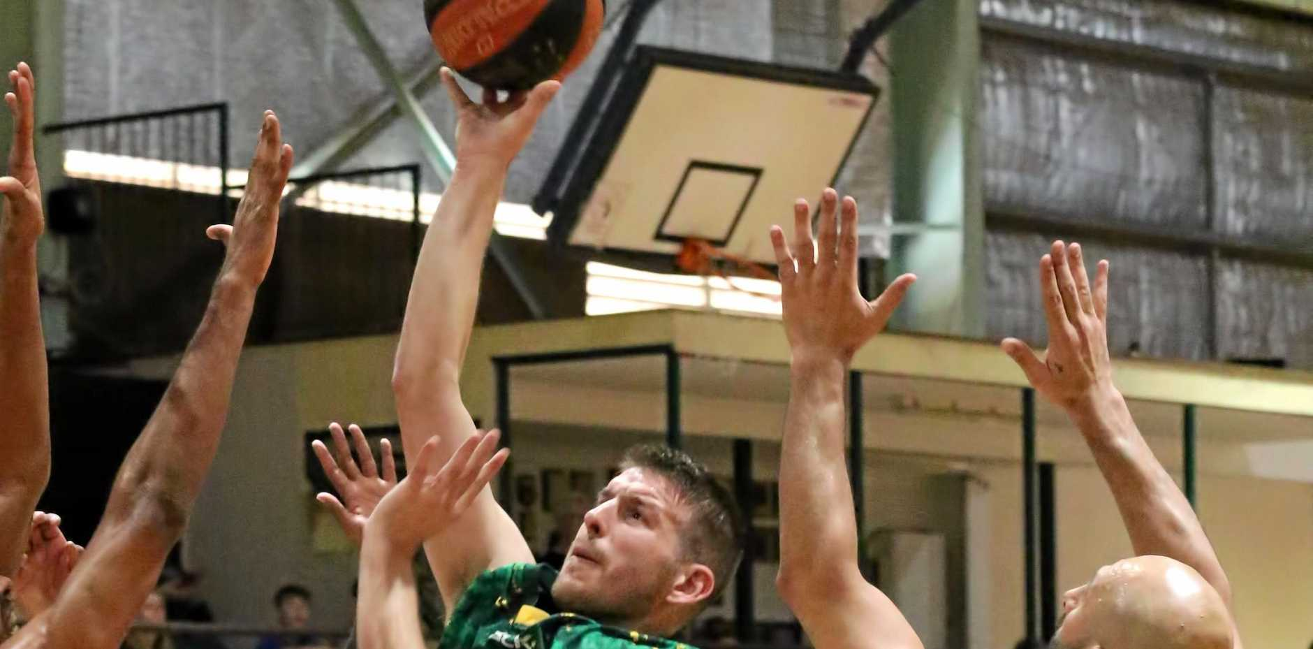 Ipswich Force vice-captain Kyle Harvey makes a determined leap in his QBL match against Logan. He top scored with 36 points in his team's latest victory over Brisbane Capitals on Saturday night.