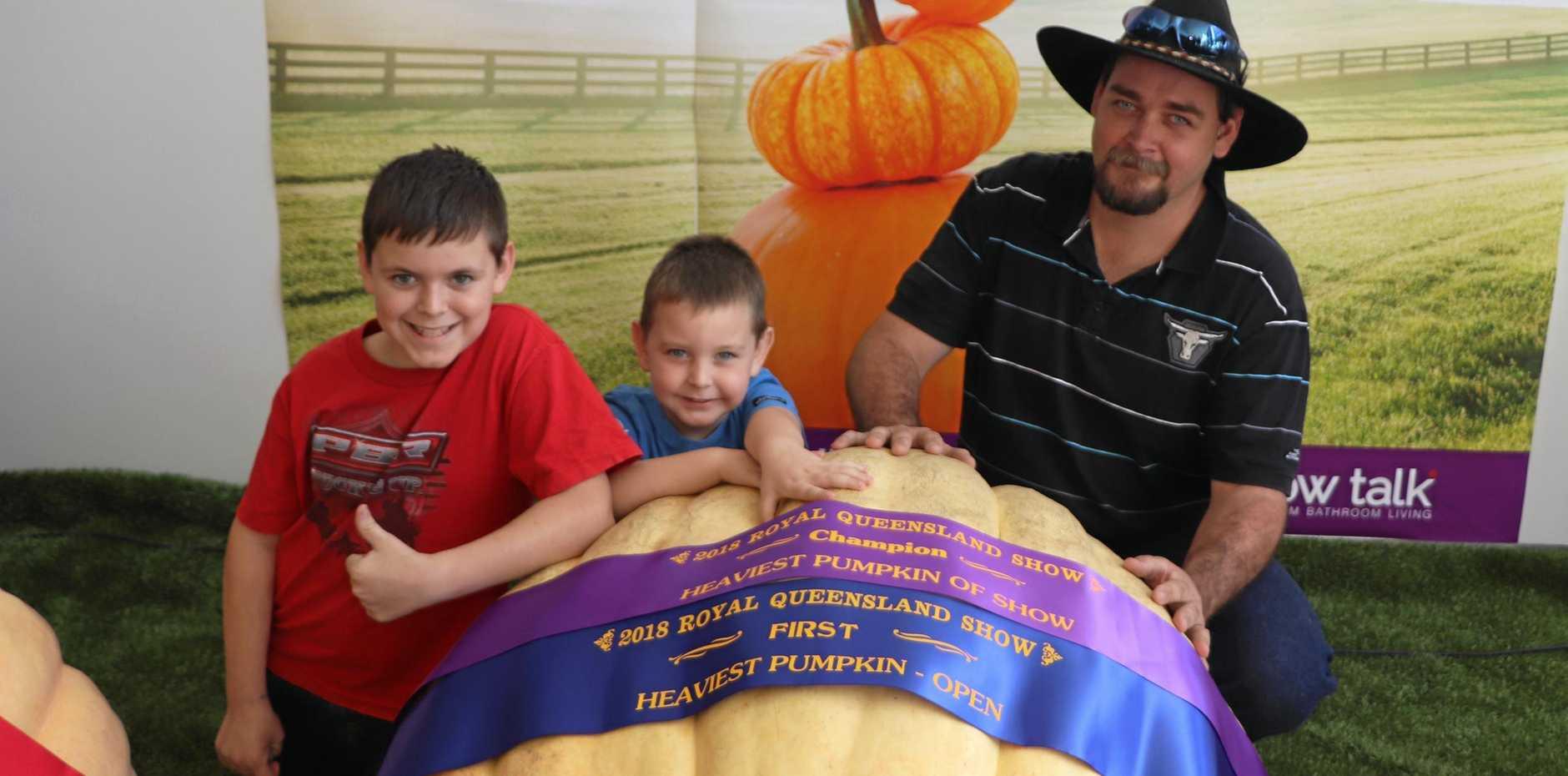 Tyler, Jackson and Steven Fritz with the winning 260kg pumpkin.