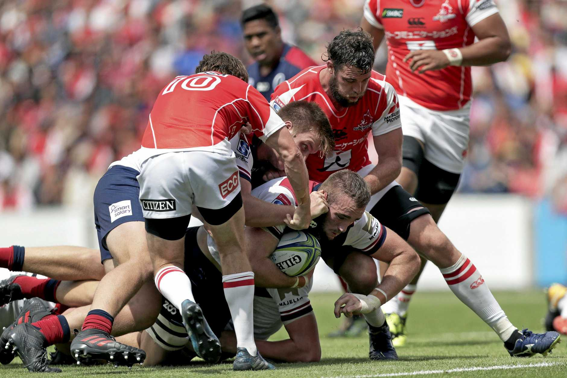 Reds prop Izack Rodda is swamped by the Sunwoves defence.