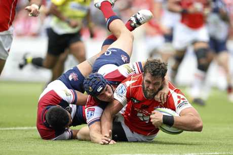 Grant Hattingh drags Reds defenders over the tryline to score for the Sunwolves.