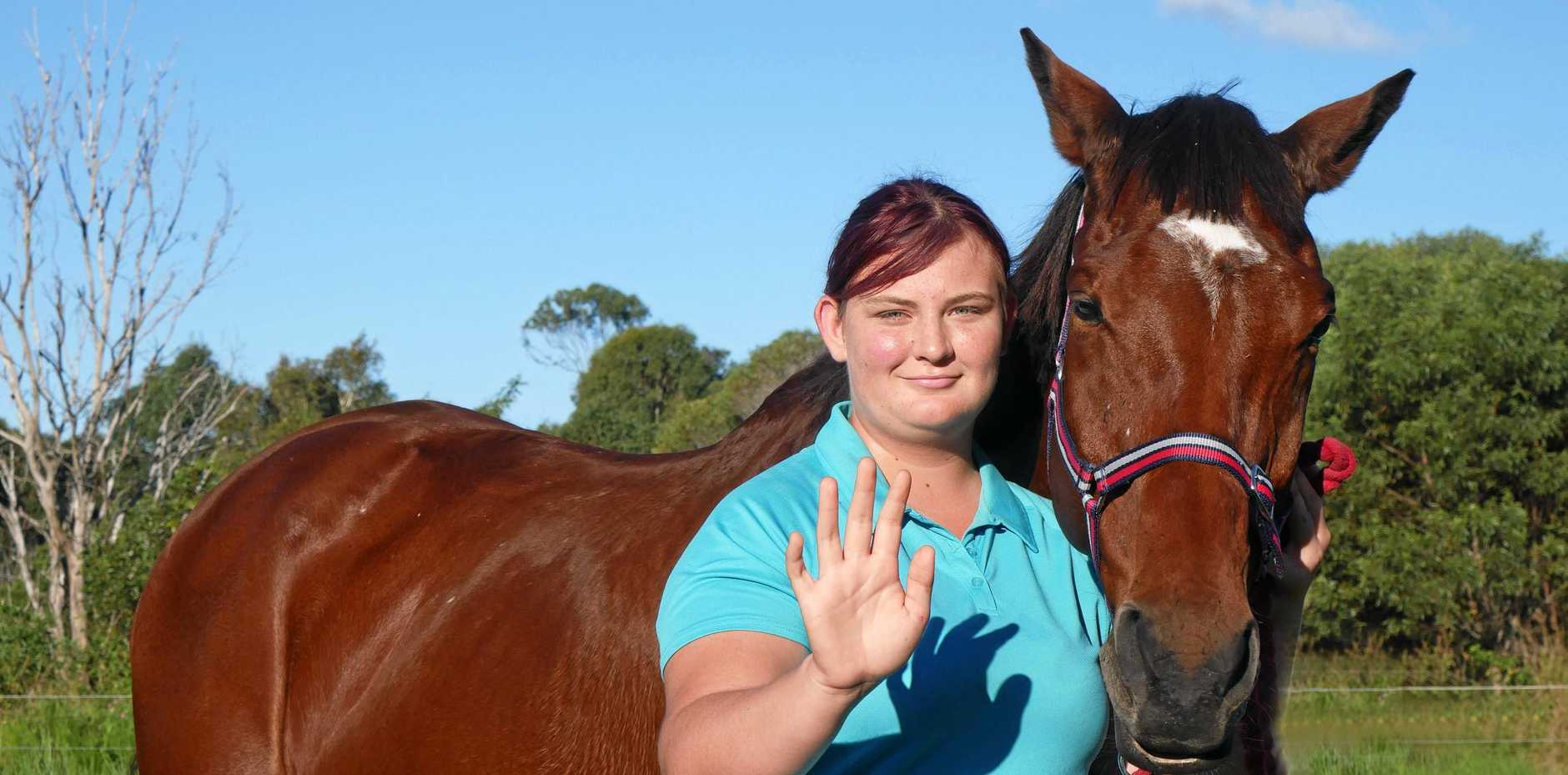 SLOW DOWN: Shamia Hill wants motorists to be aware of road rules regarding horses on roads. Pictured with horse Basil.