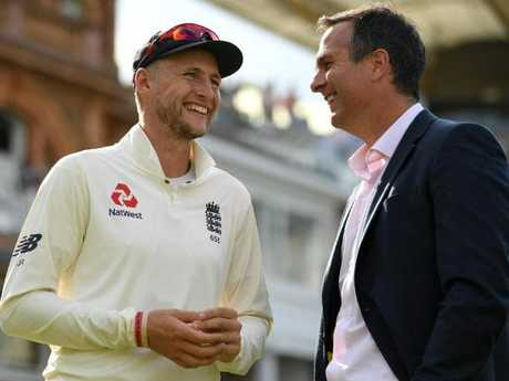 England captain Joe Root (L) speaks with former captain Michael Vaughan.