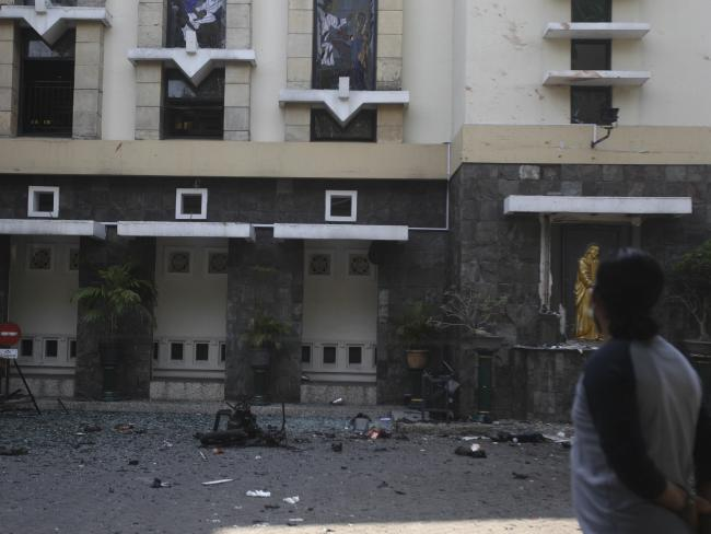 Debris is seen at a church where an explosion went off in Surabaya, East Java, Indonesia. Picture: AP Photo/Trisnadi