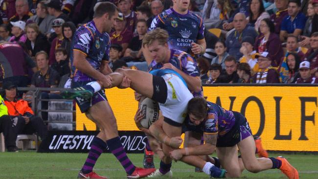Cameron Smith lifts the leg of Kevin Proctor which injures his groin.