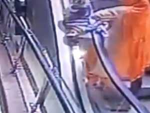 Mum drops baby from escalator taking selfie
