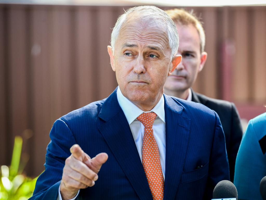 Australian Prime Minister Malcolm Turnbull (left) speaks to the media. Picture: Brendan Esposito/AAP