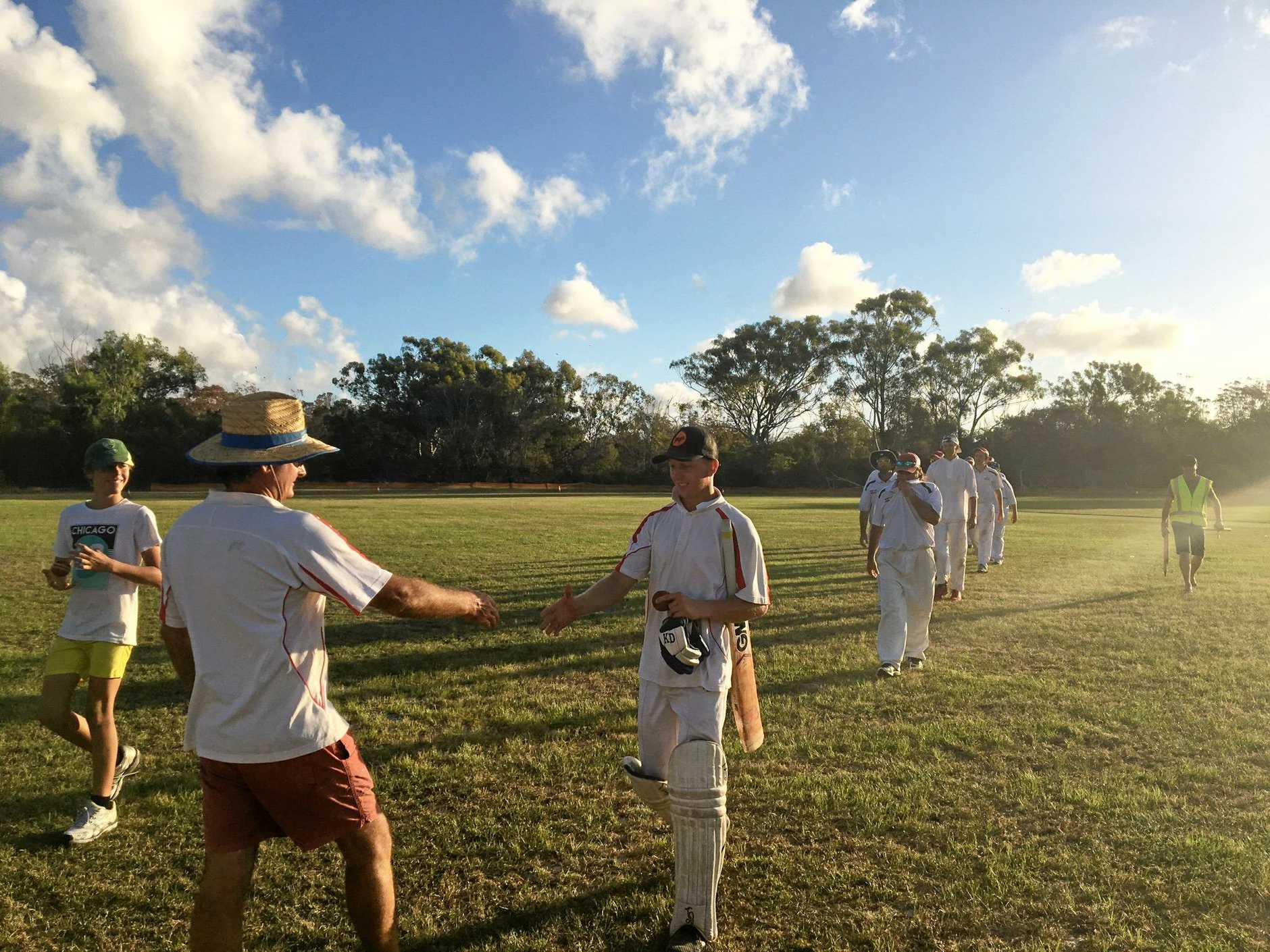 Kurtis Everett is congratulated after scoring 311 runs for rainbow Beach at the weekend.