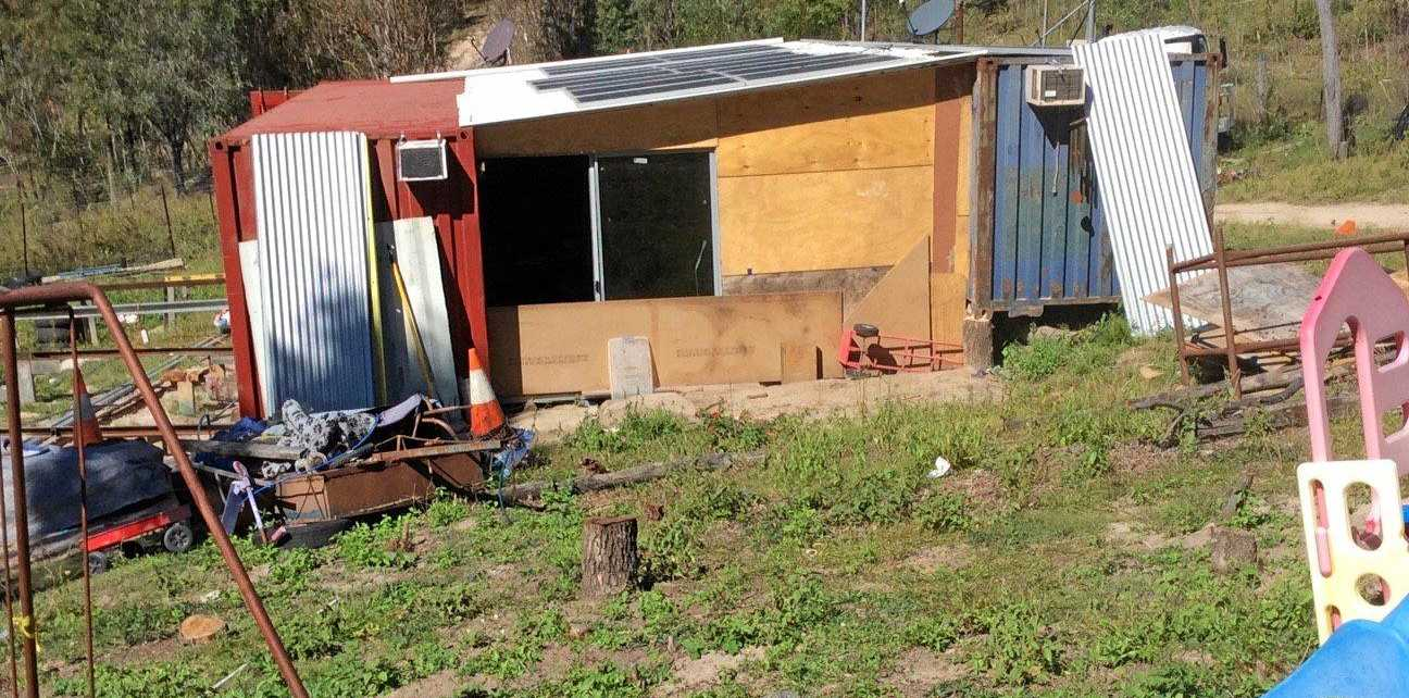 Parmaedics say they were locked inside a rural property after being called to Karl Gebicki's shipping-container house.