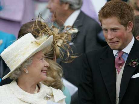 Britain's Queen Elizabeth II and Prince Harry share a joke. Picture: AFP/Alastair Grant