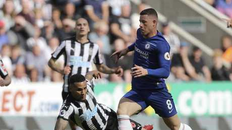 Newcastle United's Jamaal Lascelles, left and Chelsea's Ross Barkley battle for the ball