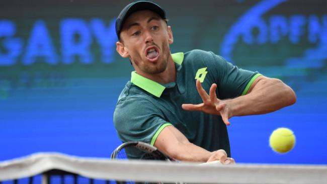 Australian John Millman on his way to victory in France. (AFP, ATTILA KISBENEDEK)