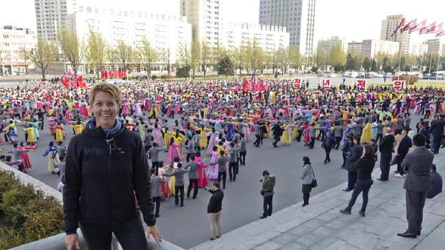 Australian travel blogger Rachel Davey at a mass dance in North Korea.
