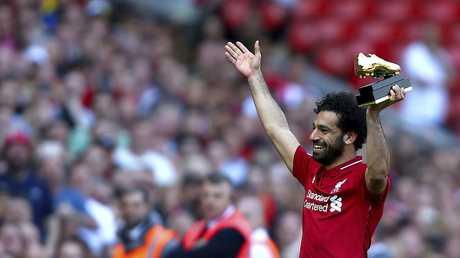 Liverpool's Mohamed Salah lifts up his golden boot award