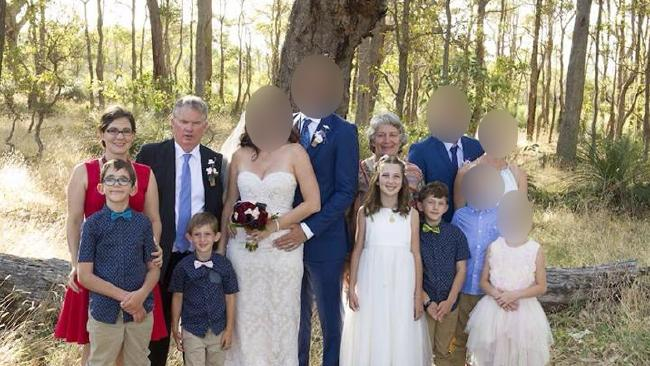 Police are investigating the deaths of the Miles family killed in a suspected murder-suicide at the property in Osmington, east of Margaret River. Back row L-R — Woman in red dress, Katrina Miles, 35. Peter Miles, 61, Cynda Miles, 58 Kids left to right: Rylan Cockman, 12, Kayden Cockman, 8, Taye Cockman, 13 (girl), Ayre Cockman, 10