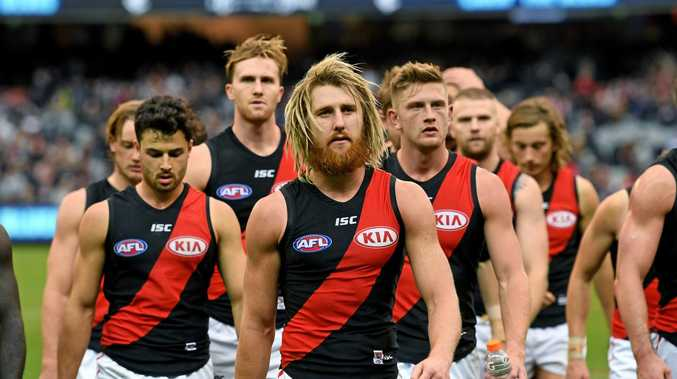Dejected Bombers walk off the ground after the team's loss to Carlton. (AAP Image/Joe Castro)