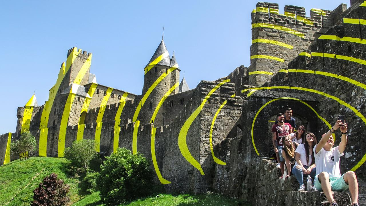 People are furious at the yellow concentric circles added to France's Carcassonne Castle by artist Felice Varini. Picture: EPA/Armando Babani