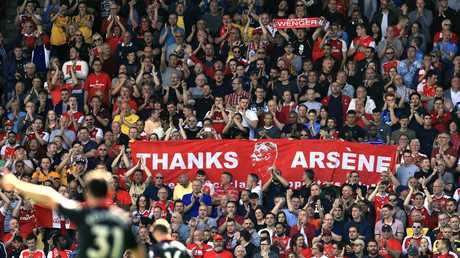 Arsenal fans carry banners supporting outgoing manager Arsene Wenger in the stands