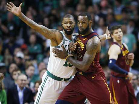 Cleveland Cavaliers forward LeBron James, right, fights for position against Boston Celtics forward Marcus Morris.