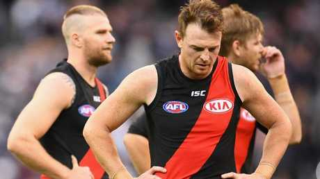 Jake Stringer, Brendon Goddard and Michael Hurley after the loss.