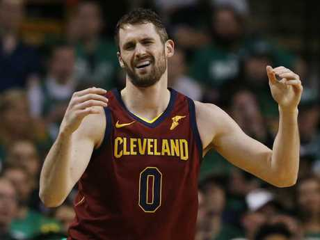 Cleveland Cavaliers center Kevin Love (0) reacts with frustration.