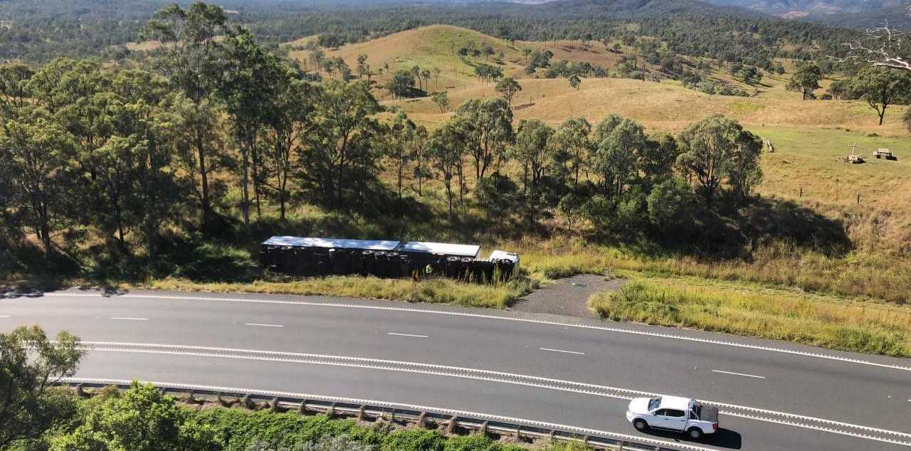 ROLLOVER: A b-double rolled onto its side on the Cunningham Highway this morning.