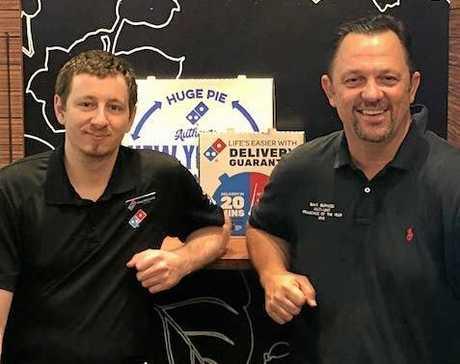 FRANCHISEE MATES: Domino' s Pizza partners Brad McCartin and Dave Burness.