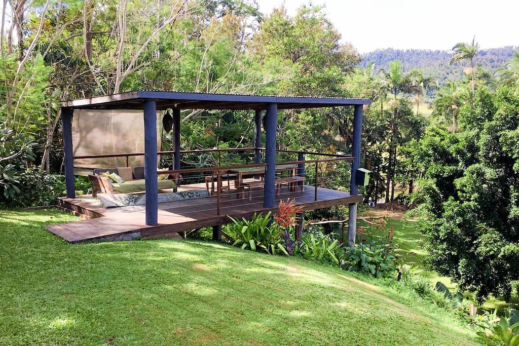 This covered deck is perfect for alfresco dining or afternoon drinks enjoying the view