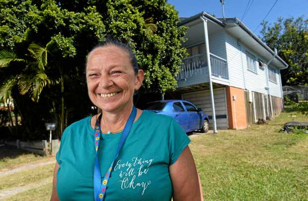 Lauraine Ormond is happy that her Goodna house has now been painted after the 2011 flood.