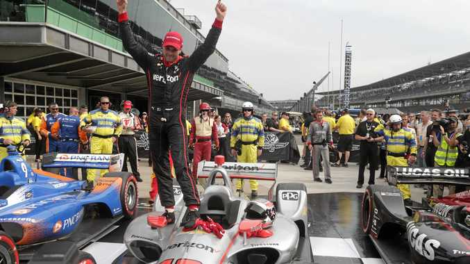 Toowoomba's Will Power celebrates his weekend IndyCar Grand Prix win at the Indianapolis Motor Speedway.