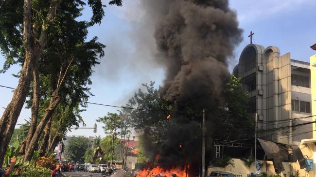 Police at the site of a blast outside the Gereja Pantekosta Pusat Surabaya (Surabaya Centre Pentecostal Church) in Surabaya on May 13. Picture: Andy Pinaria/ Pemerintah Kota Surabaya Julie Bishop IV Sunrise 15 May