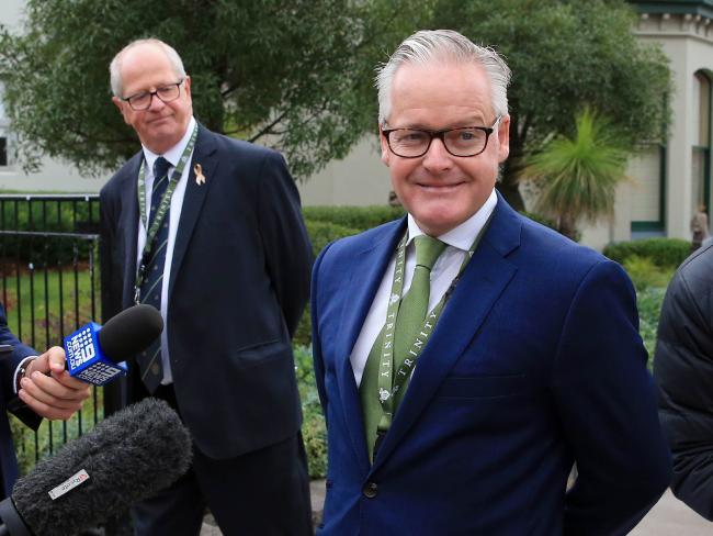 Trinity Grammar headmaster Michael Davies, right, with deputy headmaster Rohan Brown behind him. Picture: Aaron Francis/The Australian