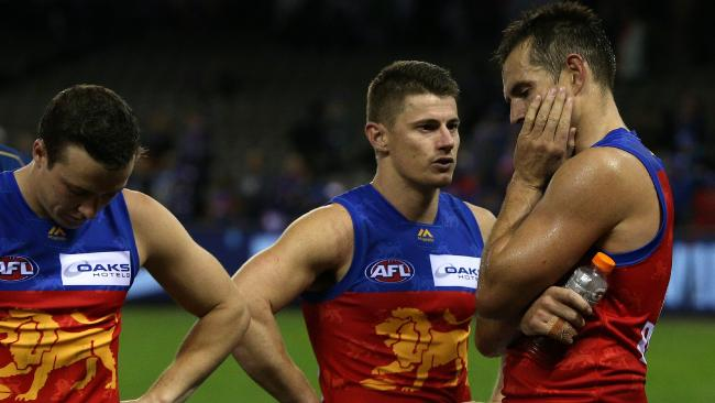 Zorko and Luke Hodge ponder Saturday's loss to the Western Bulldogs. Pic: AAP