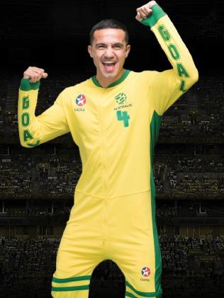 Tim Cahill models a Caltex Socceroos onesie.