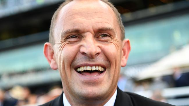 Trainer Chris Waller laughs after Winx ridden by Hugh Bowman won race 7, the Longines Queen Elizabeth Stakes during The Championships — Day 2, Longines Queen Elizabeth Stakes Day at Royal Randwick in Sydney, Saturday, April 14, 2018. (AAP Image/David Moir) NO ARCHIVING, EDITORIAL USE ONLY