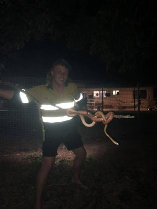 Wyatt McDonald wrangles a snake. Picture: Facebook