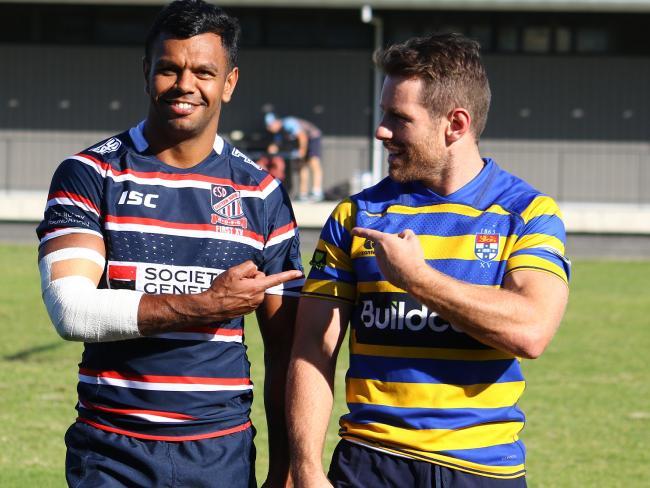 Kurtley Beale and Bernard Foley at Waratahs training in their club jerseys.